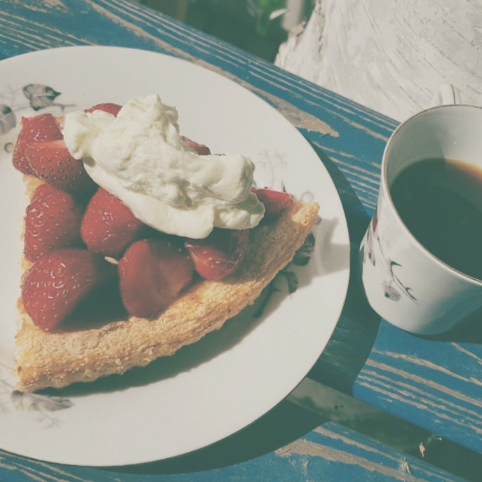 The best kind of strawberry cake with coffee served in grandma's old cup.